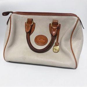 Dooney & Burke. Ivory pebbles leather medicine bag